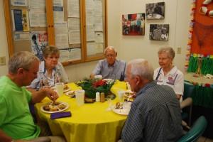 Group of volunteers eating lunch